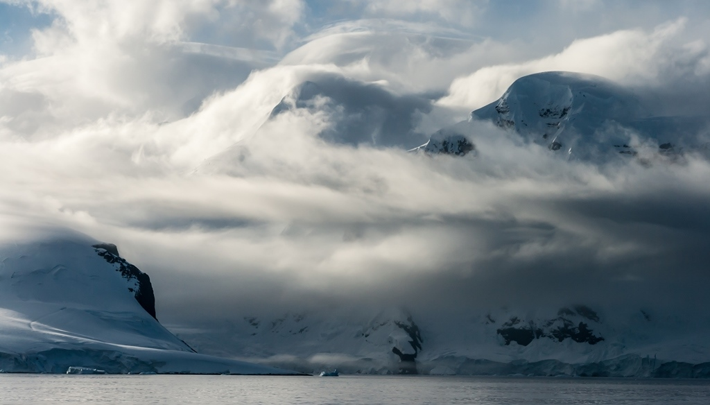 Cloud Filled Mountains of the Neuymayer Channel in Antarctica
