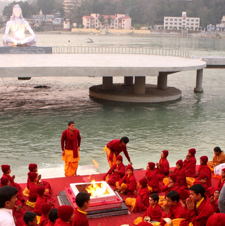 Students of one of the Ashrams praying at the banks of the Ganges