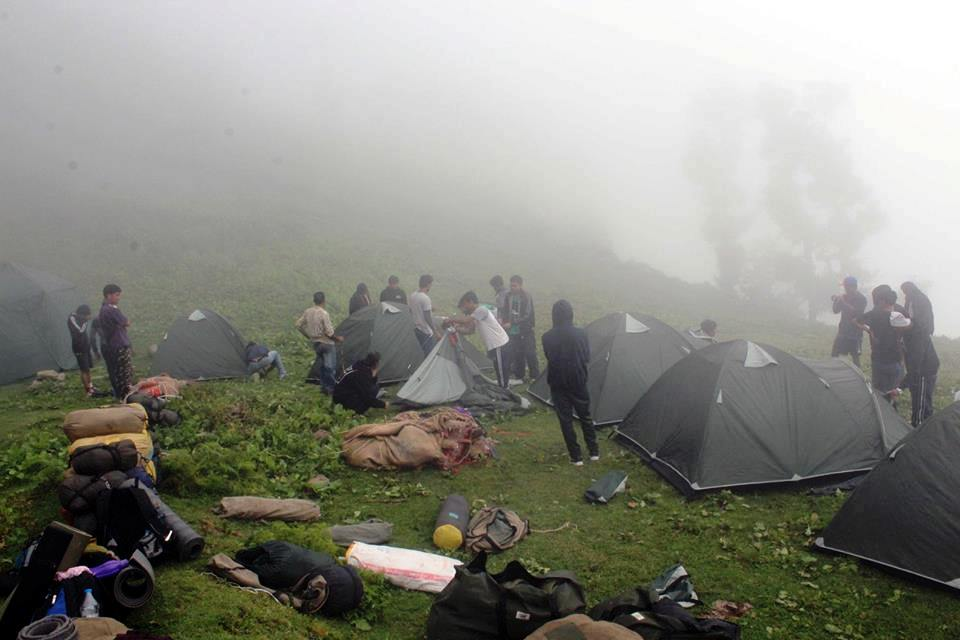 A group of students setting up camp during the Nag Tibba Trek